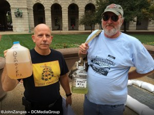 Craig Stevens and Ray Kemble display well water from Dimock, Pennsylvania.