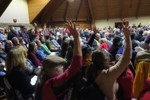 Residents of the Clear Creek area raise their hands Tuesday night to indicated they were approached by an energy company seeking to lease their mineral rights.