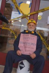 Steve Norris u-locked himself to the doors of a Dominion contractor.