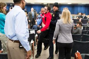 A protestor is carried out of the FERC Commissioners' meeting on March 19, 2015/Photo by Scott Mahaskey