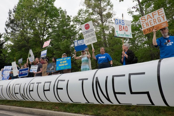 Protesters object to Dominion Resource's new natural gas infrastructure projects and its kundue influence as a utility in Virginia.