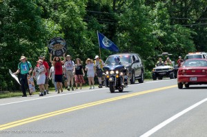 The six-mile march had a police escort./ Photo by Anne Meador